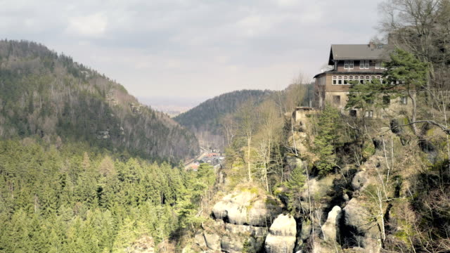 Sandstone rocks with touristic restaurant, rock massifs in forest. View of beautiful valley. video