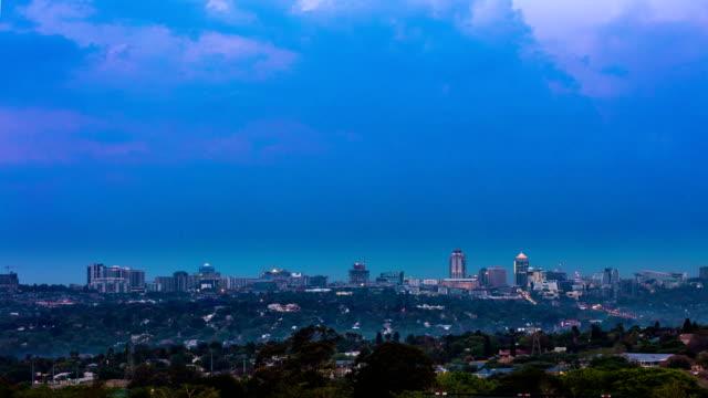 sandton city timeline at dusk cloudscape - timeline стоковые видео и кадры b-roll
