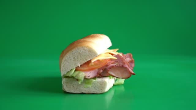 sandwich ham on green screen - kolor tła filmów i materiałów b-roll