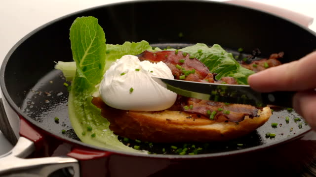 Sandwich with poached egg, salad and bacon video