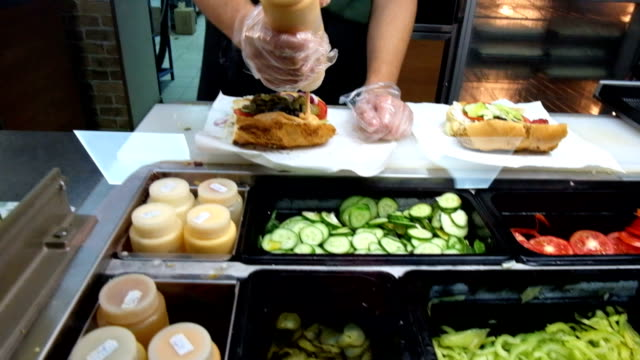 Sandwiches preparation in local fast food store video