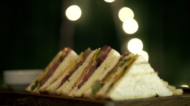 Sandwiches set rotate Sandwiches set rotate on a board. Close up menu stock videos & royalty-free footage
