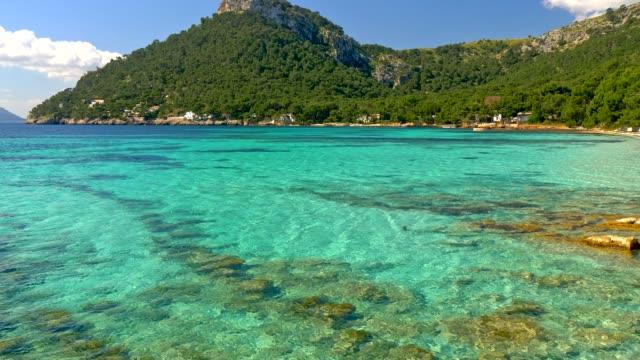 sandy beach with azure water. majorca platja de formentor beach - mallorca at balearic islands of spain - испания стоковые видео и кадры b-roll