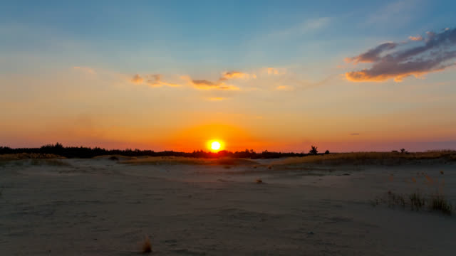 sandy desert at the sunset, outdoor natural time lapse scene