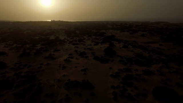 Sandy landscape at sunset, aerial view video