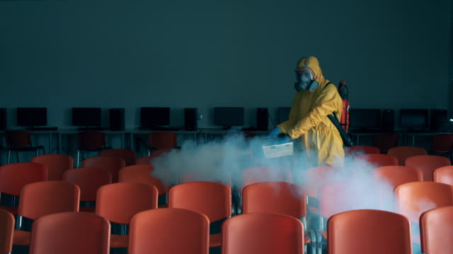 Sanitation expert is fumigating quantorium hall video