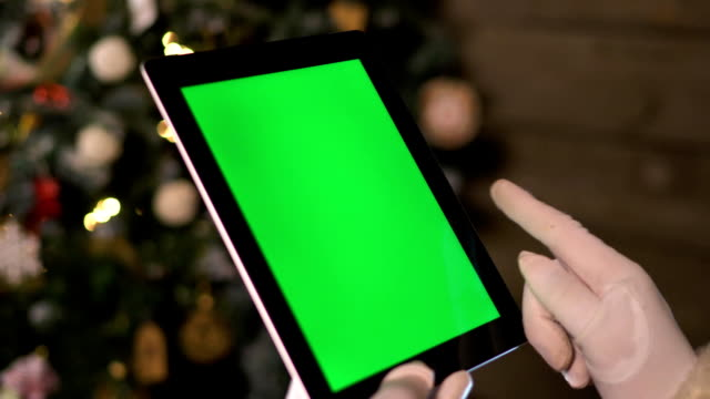 Santa Choose Gifts on TabletPC. Tablet with Green Screen video