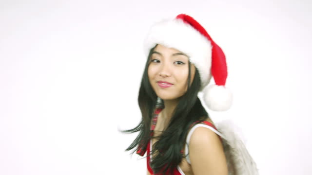 santa christmas angel asian woman cut out isolated on white video
