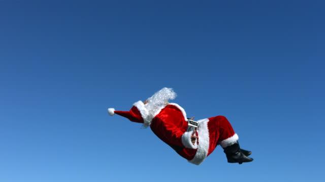 santa claus does a flip in the air, slow motion - jultomte bildbanksvideor och videomaterial från bakom kulisserna