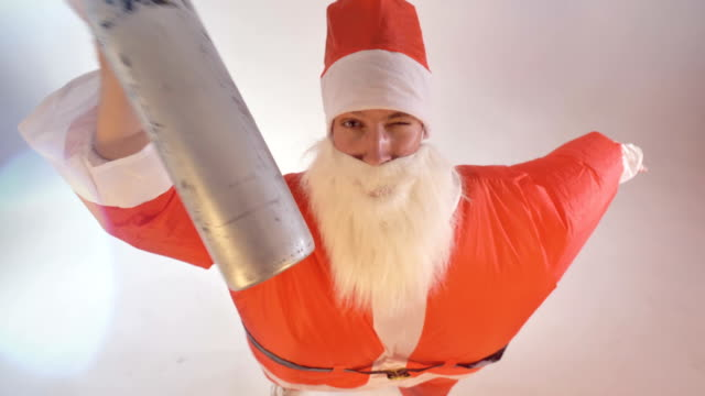 Santa Claus drinks from a bottle and falls down. video