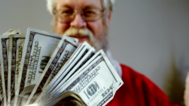 santa claus fanning currency notes - dollar bill стоковые видео и кадры b-roll