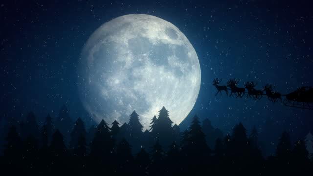stockvideo's en b-roll-footage met santa claus flying in front of the moon - rendier