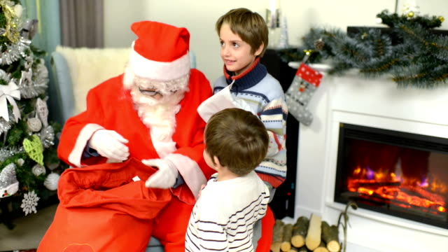 Santa Claus Giving Presents to Children video