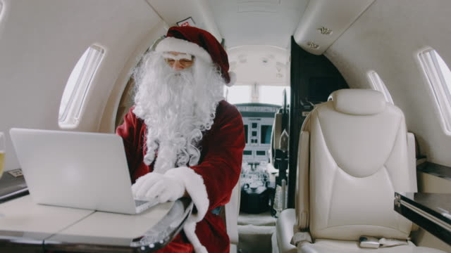 Santa Claus in private jet airplane video