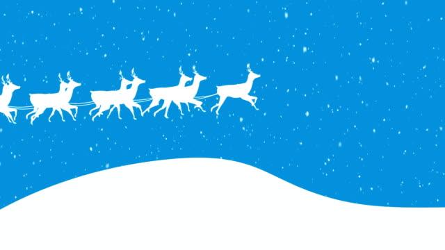 jultomten i släde dragen av renar - loopad bild bildbanksvideor och videomaterial från bakom kulisserna