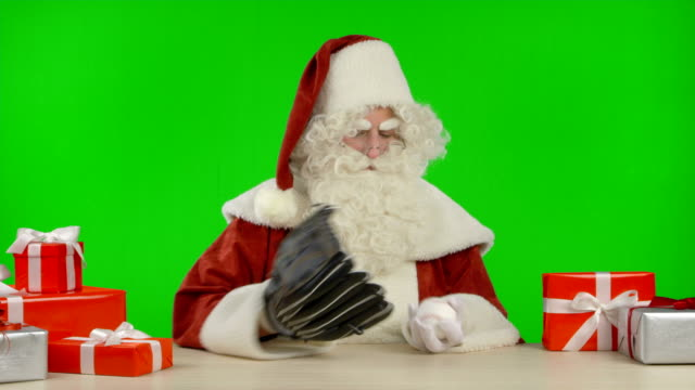 Santa Claus is Playing with a Baseball and a Catcher's Glove video