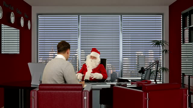 Santa Claus is signing  the contract with a Young Businessman video