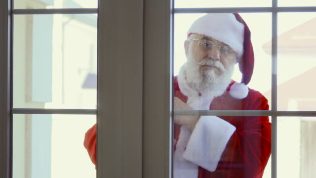 Santa Claus knocking in window