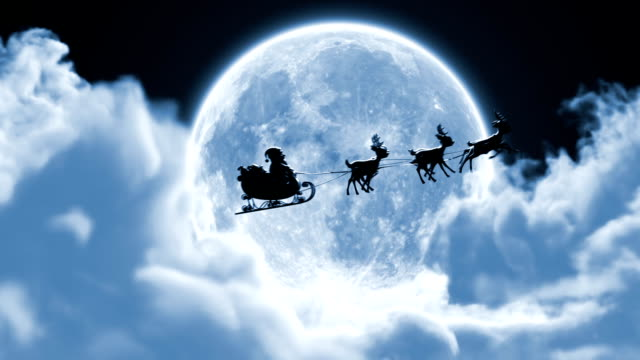 Santa Claus on a Reindeer Sleigh Flying Between the Clouds on the Background of the Moon