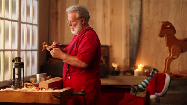 Christmas Video of Santa Claus Painting Toys in Workshop