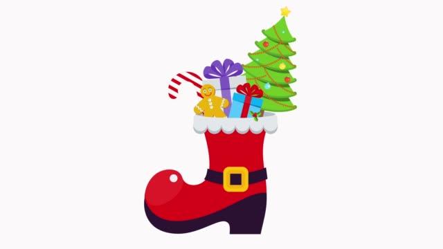 weihnachtsmann rote stiefel mit geschenk und baum - nikolaus stiefel stock-videos und b-roll-filmmaterial