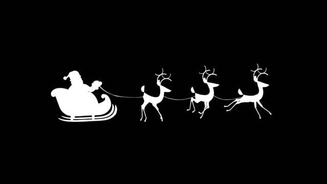 vídeos y material grabado en eventos de stock de silueta papa noel montando un trineo con renos - reno mamífero