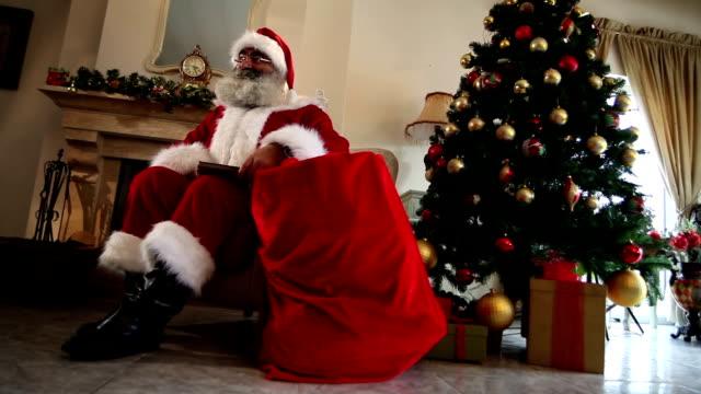 Santa Claus sitting at home video