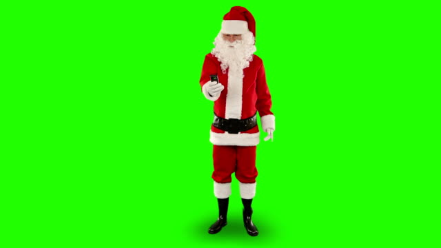 Santa Claus talking on mobile, Green Screen