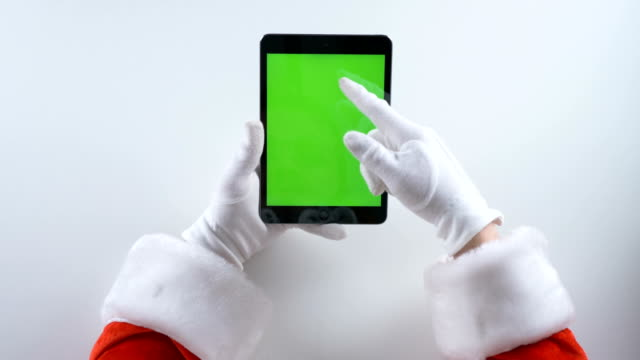 Santa Claus uses a tablet, chroma key 50 fps video