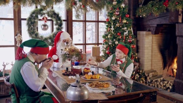Santa Claus with elves.