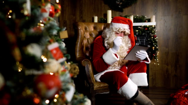 Santa Claus working with digital pad TabletPC video