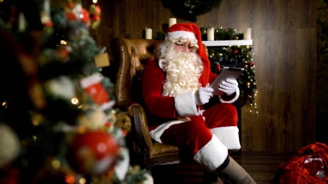 Santa Claus working with iPad