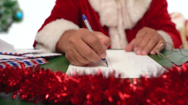 Santa Claus writing a list - close up