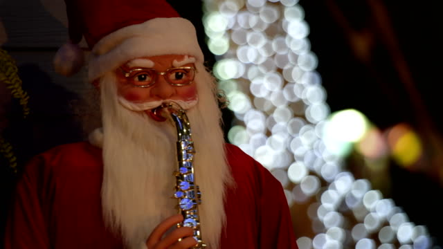 Santa clause doll play saxophone. Santa clause doll play saxophone decorate in Christmas and New Year. doll stock videos & royalty-free footage