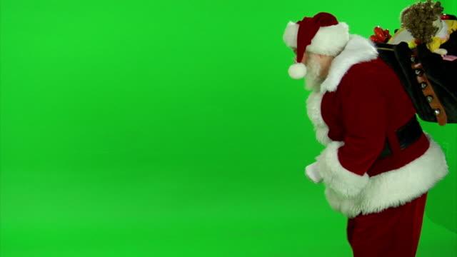 hd santa hedyotis da - santa claus tiptoeing video stock e b–roll