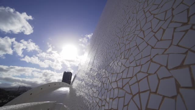 santa cruz de tenerife, spain - april, 17, 2019 - a beautiful white mosaic puzzle reflects the sun's rays at sunset. exciting lines of a futuristic building in slow motion - post modern architecture stock videos & royalty-free footage