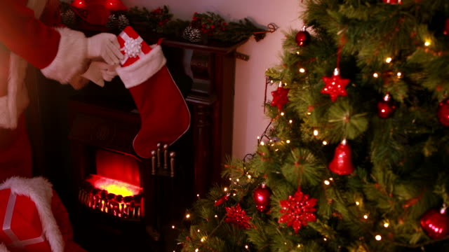 Santa delivering gifts to a home video