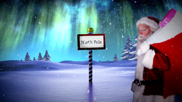 Santa delivering presents at the north pole video