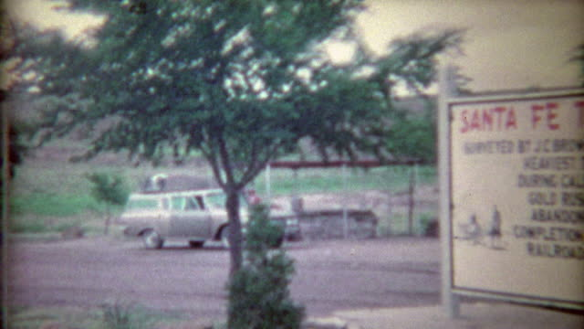 1966: Santa Fe Trail wayside with family truckster station wagon road trip.