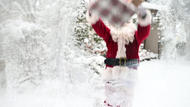 Santa Home outdoor falling down with gift