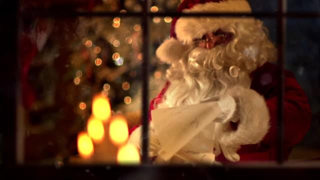 santa list slow motion - santa bildbanksvideor och videomaterial från bakom kulisserna