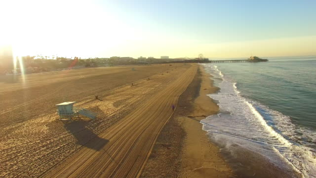 aerial santa monica beach at sunrise - aerial beach stock videos & royalty-free footage