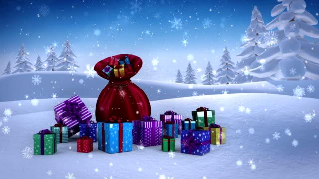 Santa sack full of gifts in snowy landscape video