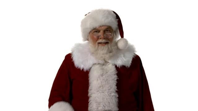 "hd santa dice ""shhhh!"" - santa claus tiptoeing video stock e b–roll"