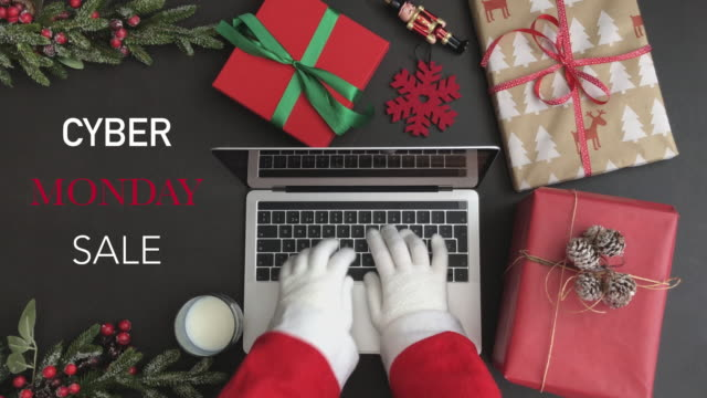 """4K Santa typing on laptop and drinking glass of milk.""""Cyber Monday SALE"""" text Santa, online, shopping, winter, papa, noel,cyber, monday, sale,xmas cyber monday stock videos & royalty-free footage"""