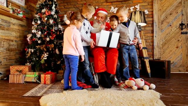 Santa writes children's wishes on laptop video