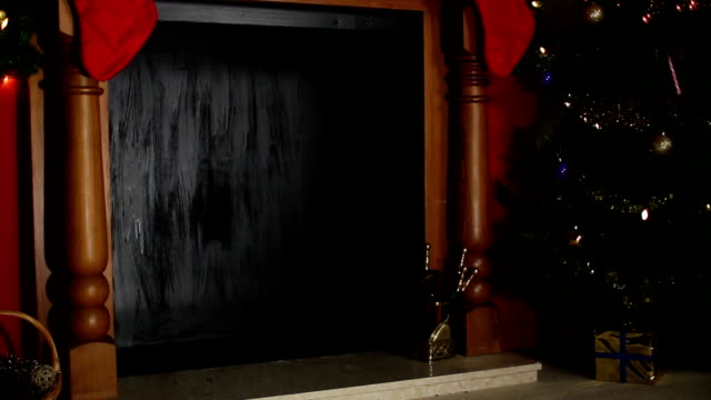 stockvideo's en b-roll-footage met santa's sack falling down the chimney - schoorsteen