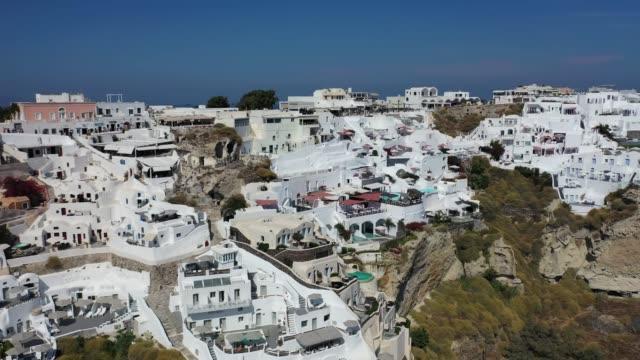 santorini. en stad av vit sten på en grekisk vulkanisk ö i egeiska havet. - stenhus bildbanksvideor och videomaterial från bakom kulisserna
