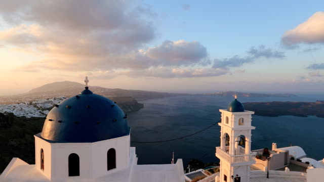 Santorini Church with blue dome by Aegean Sea. Church bells on Santorini island which is one of the famous tourist attraction. Time lapse video