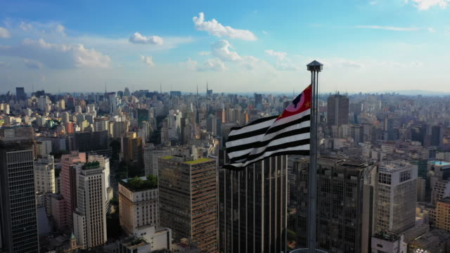 Sao Paulo Downtown Aerial View São Paulo Downtown from above with the state flag fluttering on the top of classic building, Altino Arantes são paulo state stock videos & royalty-free footage